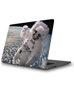 Artists Concept of an Astronaut Floating in Outer Space Apple MacBook Pro Skin